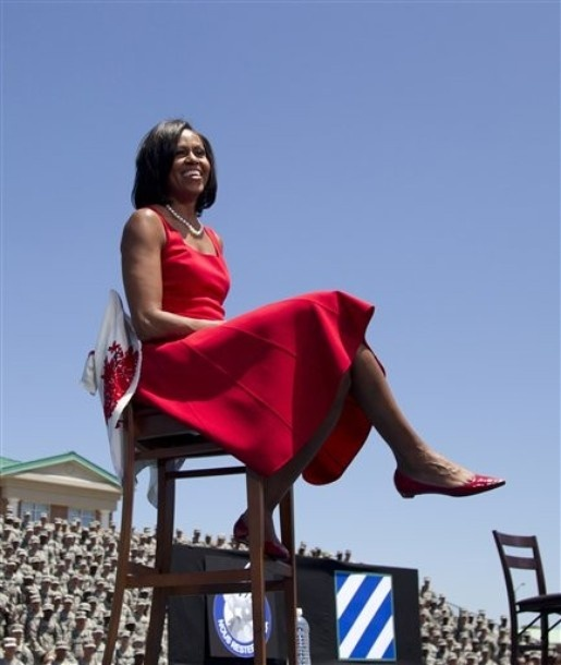First lady Michelle Obama sits on stage as President Barack Obama speaks to troops, veterans and military families at the Third Infantry Division Headquarters, Friday, April 27, 2012, at Fort Stewart, Ga.  AP PHOTO