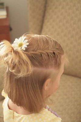 french braid/twists with messy bun and flower hairdo on little girl