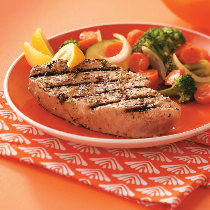 """Garlic Herbed Grilled Tuna Steaks Recipe -""""After enjoying yellowfin tuna at a restaurant in southwest Florida, I came up with this recipe so I could enjoy the flavor of my favorite fish at home."""" —Jan Huntington, Painesville, Ohio"""