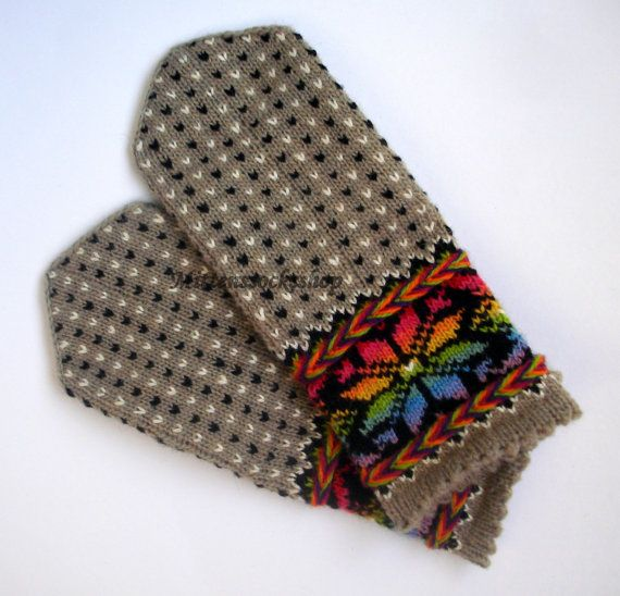 Hand knitted wool mittens.Warm mittens.Rainbow. Rainbow color pattern on the gray background.Christmas gift idea.