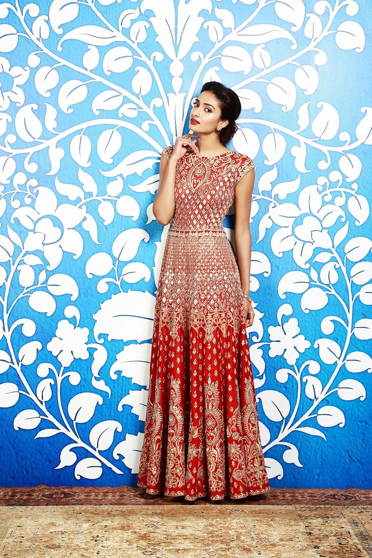 <p>An exquisite raw silk and net, red gown enhanced with intricate gota patti embroidery.</p><p><strong>Disclaimer</strong> - We require 3-6 weeks for the dispatch, as the product is customised.</p>