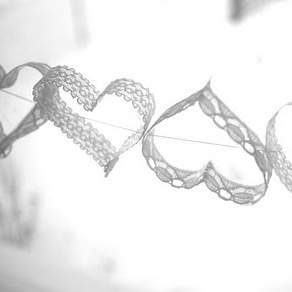 Lace Heart Garland {DIY} All you need to make these darling lace heart garlands is some lace, a heart shaped cookie cutter, Mod Podge, a paint brush, a needle and thread, and a pair of scissors. could be used to decorate trees {they'd look dreamy alongside fairy lights!} they'd also make a pretty photo booth backdrop or how about making mini lace hearts, attaching them to lolly sticks and using them as cupcake toppers?