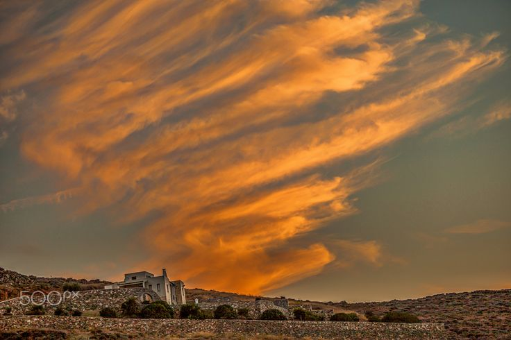 House On The Hill - One of many  amazing sunsets on the island of Syros in Greece in winter.  www.macsnapshot.com