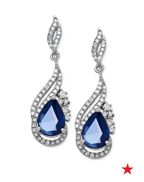 These breathtaking sapphire and diamond drop earrings make a shining statement on your wedding day. Pair with a glamorous updo for a stunning and unforgettable look.