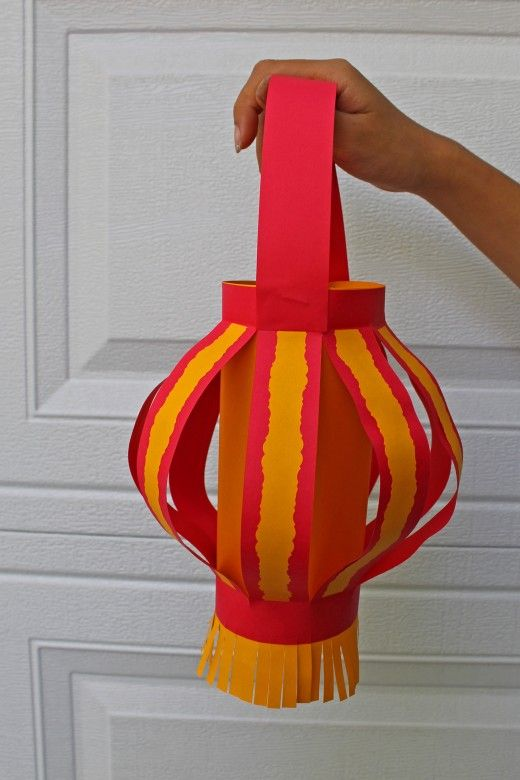 "A spin on the Chinese paper lantern-- cut decorative stips to put on the ""ribs"" of the lantern. Simple to do with decorative scissors. Good for Chinese festivals--new year, lantern festival. Can make at home with just a few supplies."