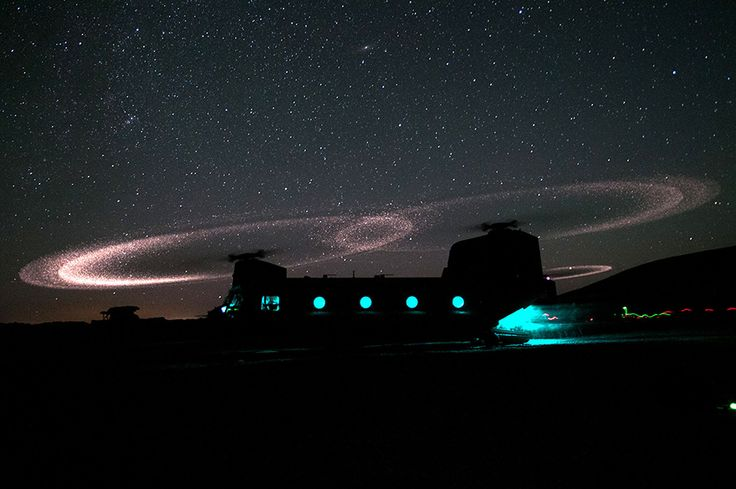 CH-47 Chinook, photographed with Kopp-Etchells Effect (Basically it is a result of static electricity created by friction as materials of dissimilar material strike against each other. In this case titanium/nickel blades moving through the air and dust)
