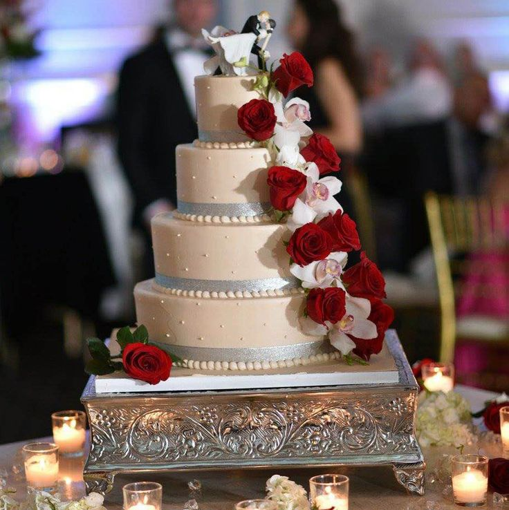 wedding cakes northern new jersey%0A This elegant buttercream ivory wedding cake features fresh red roses and  orchids cascading down the side