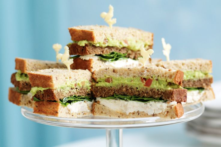 Boost everyone's energy with layers of rye, avocado and chicken on these tasty triple-decker finger sandwiches.