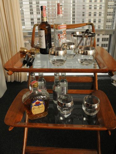don draper bar cart. can you imagine your boss letting you have a nicely stocked bar cart by your desk today?
