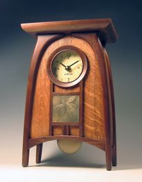 Glasgow mantle clock in oak and walnut with flat top, round face, and dragonfly motif, by Cats Eye Craftsman.