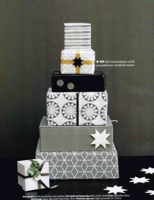 A Tower of gifts - wrapped and decorated with Black and White flat folded stars. Made by Stjernestunder.dk Featured in ALT for damerne 47/2013