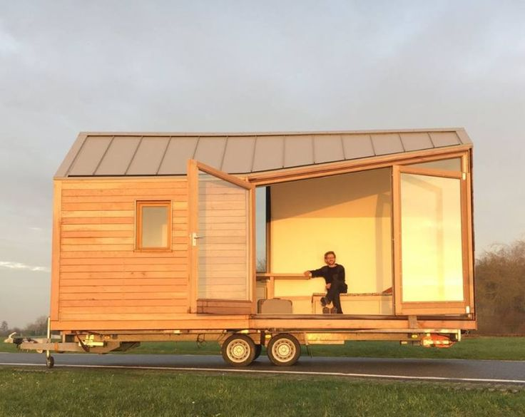 Porta Palace tiny house on wheels The minimalistic wooden building envelope combined with large fold-out glass doors adds unique aesthetics to this tiny house on wheels. Made by Dutch design studio WoonPioners, it is made from CLT boards that ensures thermal efficiency and sound insulation too. This tiny house comes complete with living area, kitchenette, bathroom, and a sleeping loft.