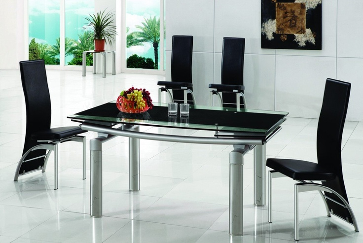 Description  Dimensions:   150 x 90 x 75cm Extends to 220cm (Table)   45 x 44 x 105cm (Chair)    Impress your guests with this Glass Dining Table, featuring an extendable glass tabletop and an ultra modern metal design. It comes with a choice of glass colour, black, red or frosted, so you can create the perfect modern look for you.