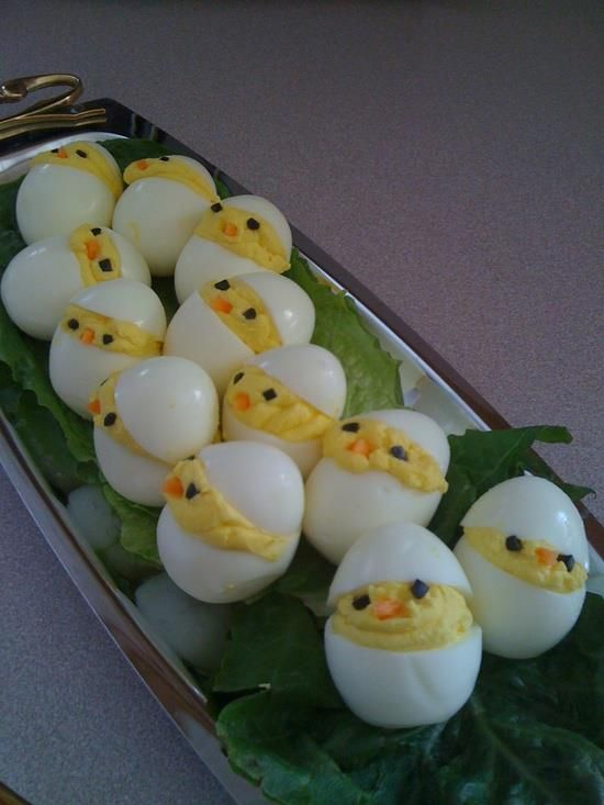 Little chicks deviled eggs.  Going the rounds on FaceBook.  Really cute!  Olive pieces for eyes, carrots for nose.