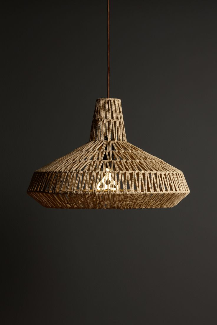 Baby Plumen 001 in a Habitat Wilbur Rattan Pendant Lampshade - (available at - http://www.habitat.co.uk/ )