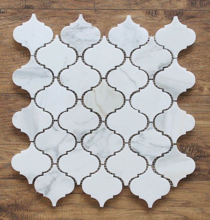 Calacatta Gold is a stunning and timeless tile choice for a kitchen backsplash or bathroom tile project! Mostly white in color with streaks of gold and grey thr