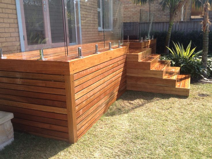 Spotted Gum Deck with glass balustrade #hardwooddeck #spottedgum #deck #glass fence #landscapeideas
