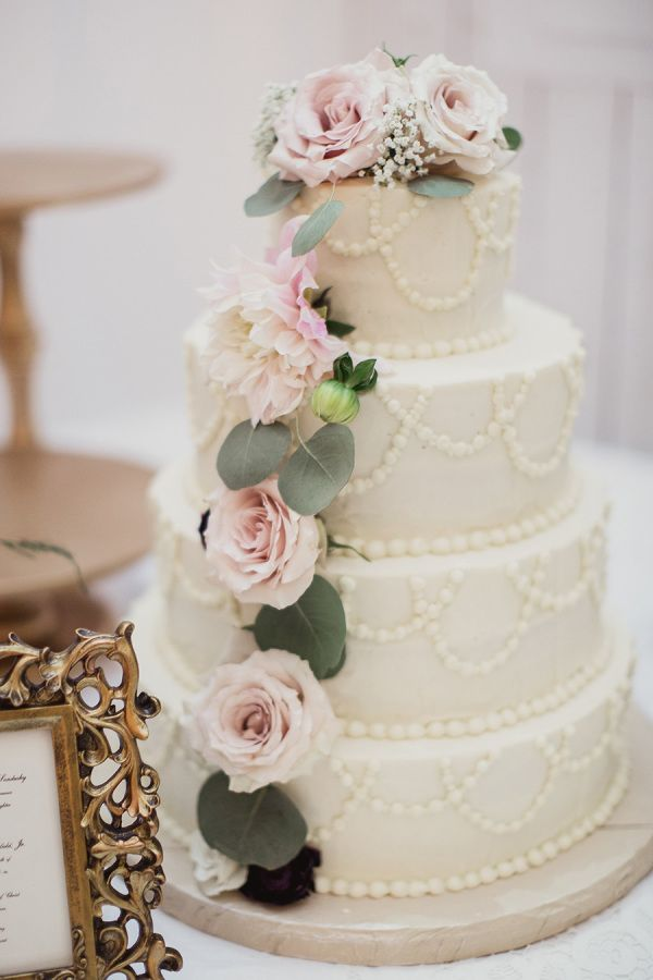 Rustic floral topped wedding cake: http://www.stylemepretty.com/2016/03/31/rustic-white-sparrow-barn-wedding/ | Photography: Shaun Menary - http://shaunmenary.com/