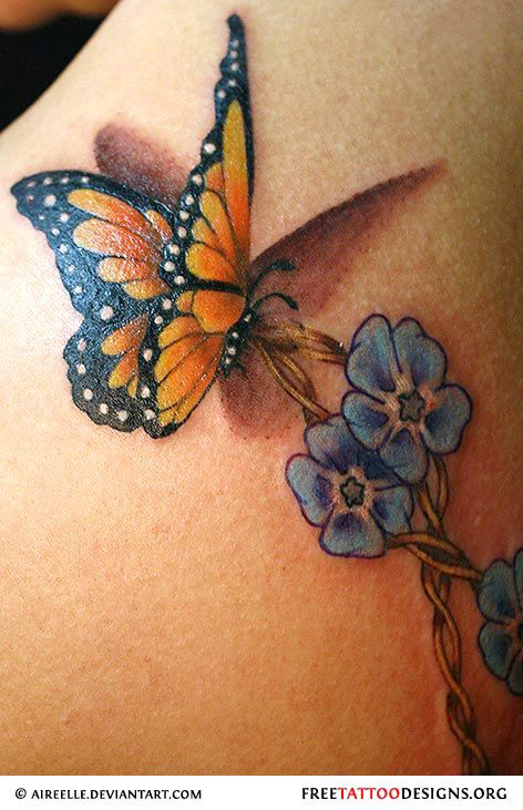 Butterfly and violets tattoo | butterfly tattoos ...