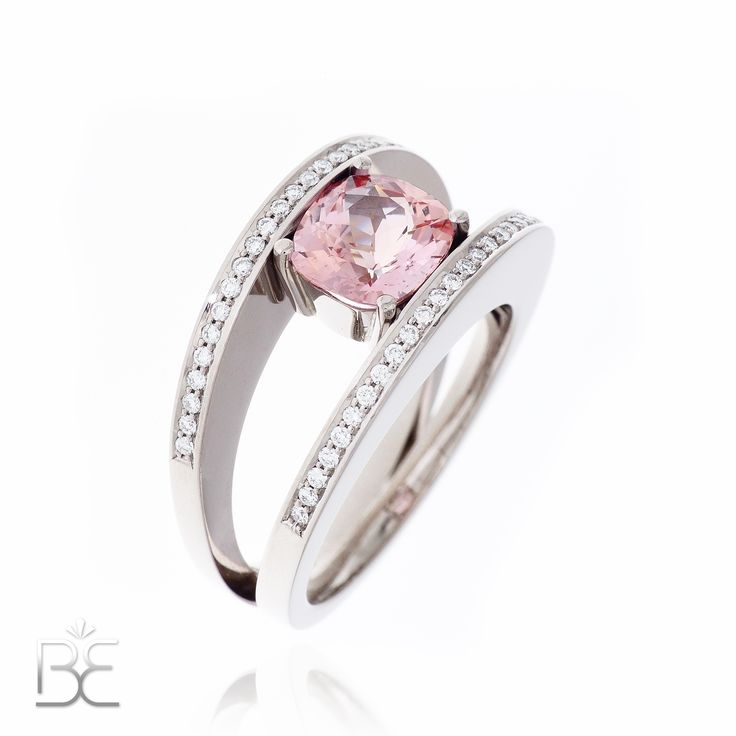 White gold ring, orange/pink sapphire (padparadscha) and diamonds. Contemporary dutch design. Handmade by Sabine Eekels