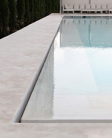 Minimal swimming pool edge detail. Pinned to Pool Design by Darin Bradbury.