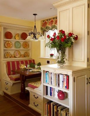 I would really like a booth in my kitchen.  I love this idea with the drawers underneath the seat.