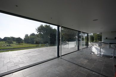 The call for bigger and better has brought minimal windows to the forefront of high end architectural glass solutions. Oversized sliding glass doors can hold 12m2 of highly insulated triple glazed glass in a slim, frameless aluminium frame. http://www.glassonweb.com/news/index/20721/