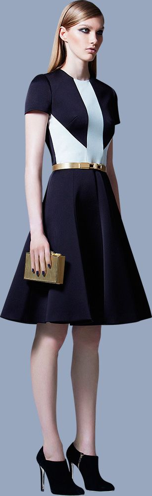 Elie Saab Pre-Fall 2013. This cute navy number with bold white arrow-detailing is a fantastic summer dress, and would make a great sailor-themed outfit.