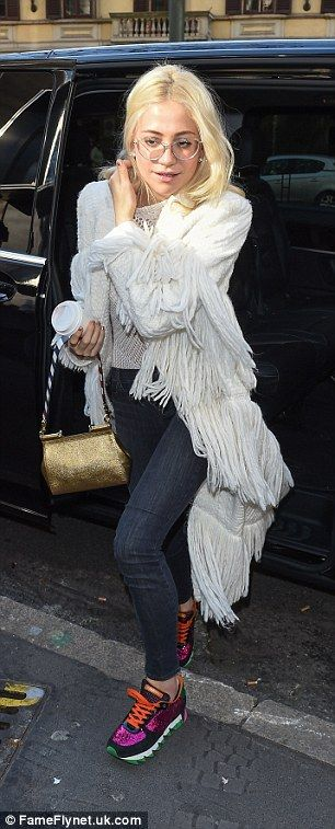 Details: She accessorised with a chic gold handbag which featured a nautical strap