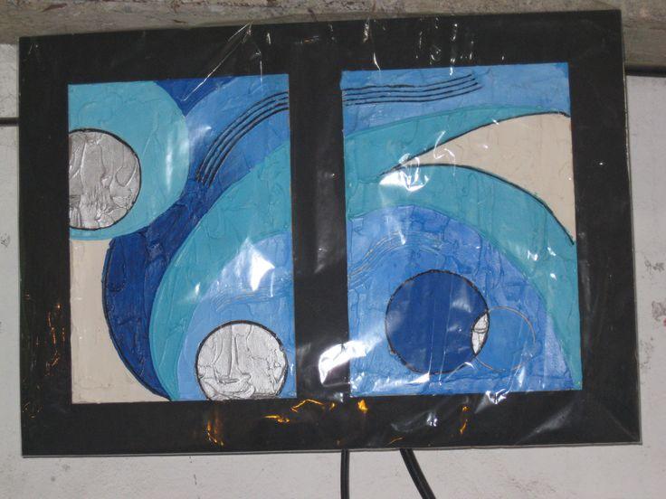 Cuadro en tonos de azules y detalles plateados. Abstracto