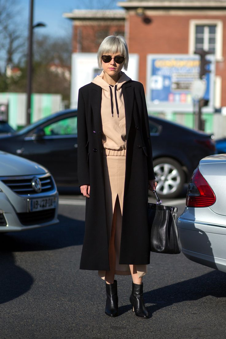 """Try Out The Khaki Comeback With A Not So Girly """"Little Tan Skirt"""" #refinery29  http://www.refinery29.com/khaki-skirt-outfits#slide-4  A hoodie paired with a front-slit skirt is a combo we wouldn't expect to work, but it definitely does...."""
