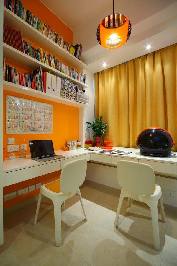 home office ideas--orange = energy Love! A little office with an orange theme to promote learning.