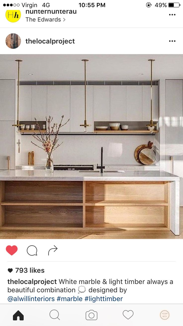I like the white and light colored wood combination - maybe we can use this lighter wood on the panels on either side of the range?