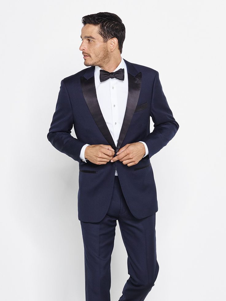 Browse the collection of tuxedos and suits offered by theblacktux.com. On offer: Contemporary styles and fits in a midnight blue tuxedo, a shawl collar tuxedo, a notched lapel tuxedo, a  gray suit, navy suit, and charcoal  suit.