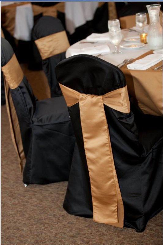 Black crown back chair covers, gold sashes