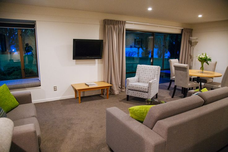 Our spacious one bedroom suite/two bedroom apartment living & dining area boasting its refurbished look.  There is just a hint of vibrant green in the decor.