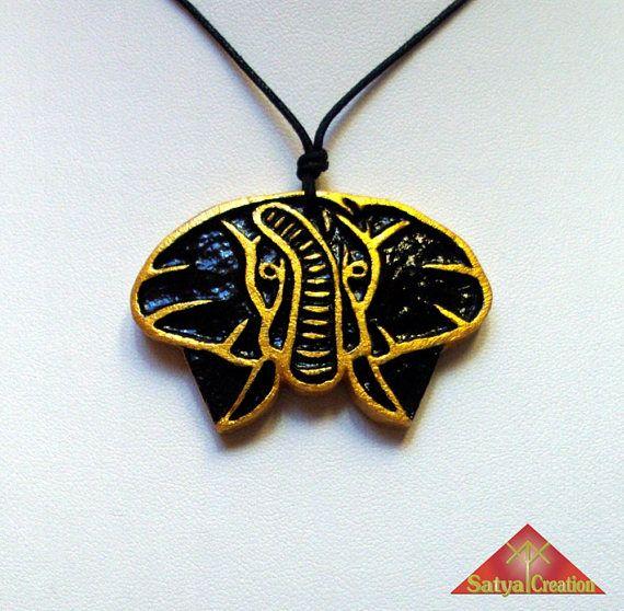 Pendentif éléphant argile or et noir animal totem