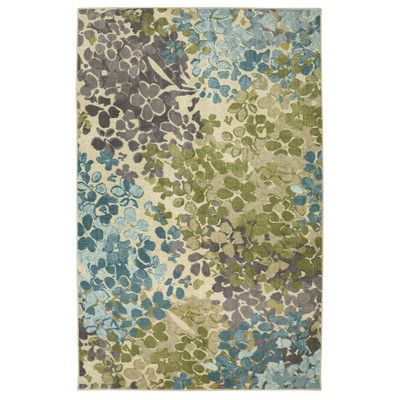 Lend a dash of garden-inspired style to the master suite or accent the entryway with this lovely rug, showcasing a vibrant floral motif.