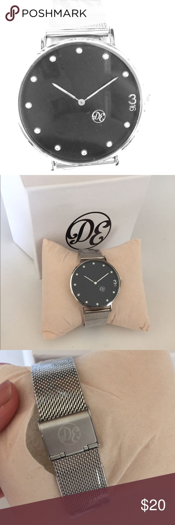 Mens Silver watch BRAND NEW Brand new DE silver watch. Studds are diamonds. Black face with a silver band - great gift for your man! DE Accessories Watches