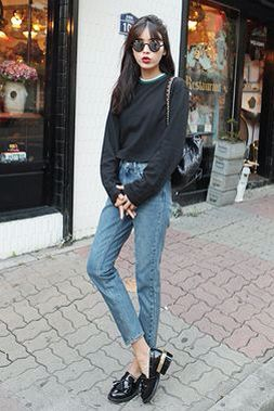 Cropped black shirt/jumper with jeans.