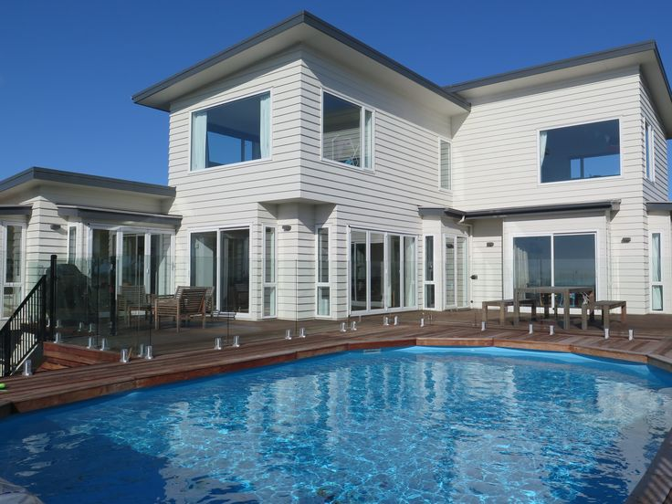 The new pool area at this Mt Pleasant home combines DuraPanel and Glass Fencing for a safe and effective solution.  The owners chose our Glass Fencing on three sides so as not to obstruct their view, and indeed it allows a seamless outlook to breathtaking views of the sea on one side and the hills on the other.  Both DuraPanel and Glass Fencing are compliant with NZ pool and balustrade safety standards.  For more inspiration check out www.boundaryline.co.nz/case_study/
