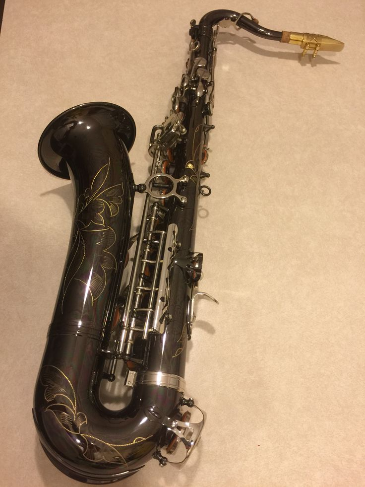 Left side of modern C melody saxophone. This one doesn't bust me in the mouth if I let go of it, unlike my Selmer.