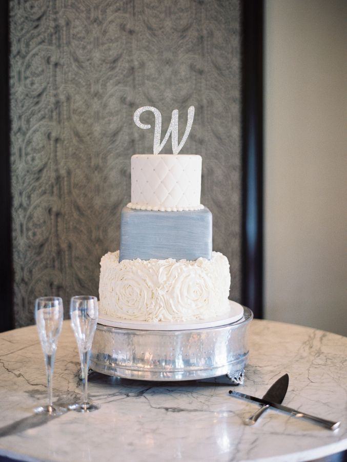 Unique different tier floral, slate blue, and diamond textured wedding cake topped with initial: http://www.stylemepretty.com/oklahoma-weddings/oklahoma-city/2016/09/30/pink-navy-garden-wedding/ Photography: Sheradee Hurst - http://sheradeehurstphotography.com/