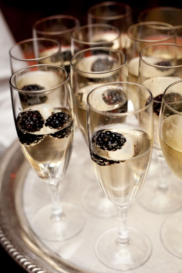 Champagne with blackberries.