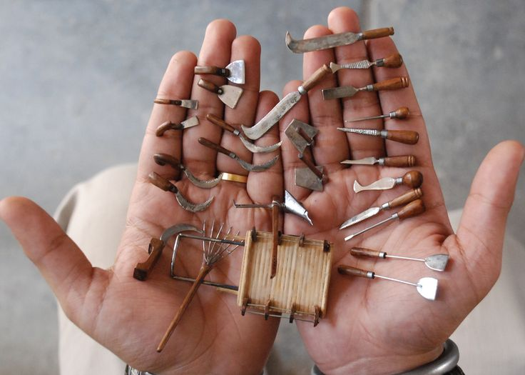 2014S373 – Miniature Agriculture Tools - Unique World Records Limited