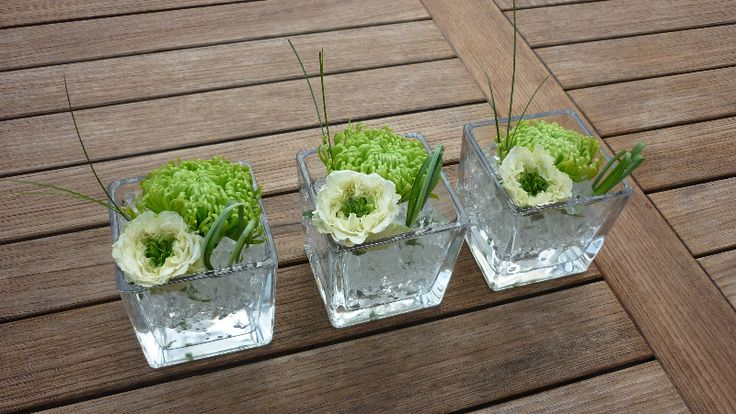 Table arrangement - small vases with chrysanthemums in gel