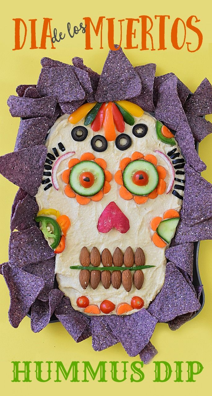 This healthy appetizer idea of Dia de los Muertos Hummus Dip is dressed to impress your guests for your next Halloween party!                                                                                                                                                                                 More