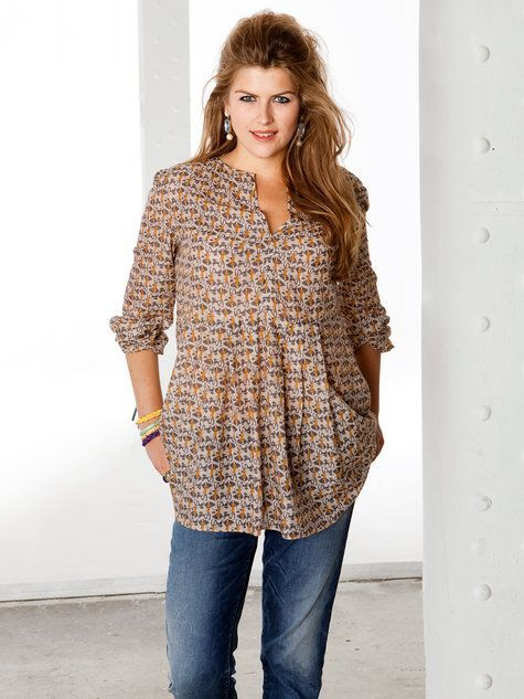 Not sure tunics look good on me but I'd be willing to try it on. Like the colors in the tunic.