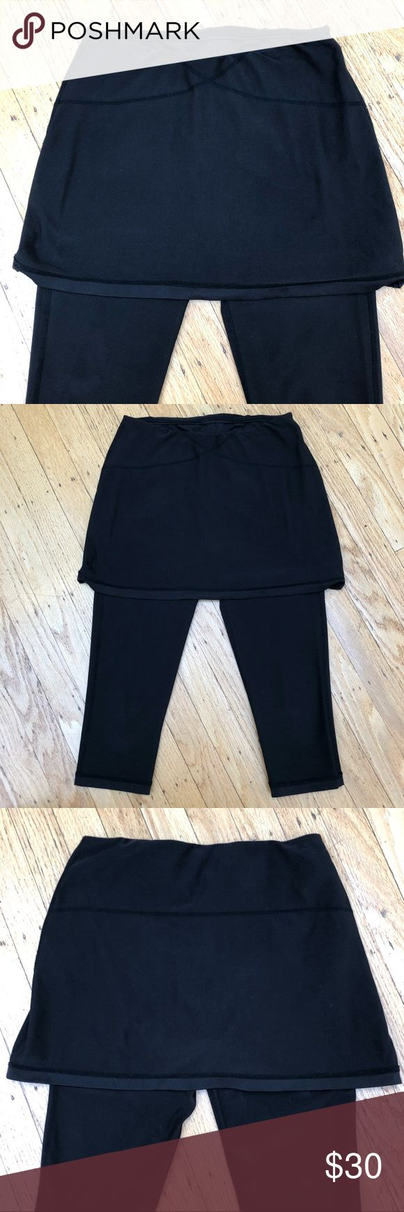 Athleta Capri legging with built in skirt XS Black Capri leggings with small pocket on inside perfect for tennis on a cold day or going to the gym! Excellent condition. Athleta Pants Capris