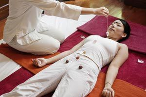 Woman receives crystal therapy. - Matthew Wakem/The Image Bank/Getty Images
